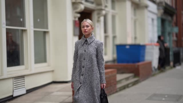 guest wears a gray long coat, a dior bag, pointy glitter shoes, earrings, during london fashion week february 2020 on february 17, 2020 in london,... - glittering stock videos & royalty-free footage
