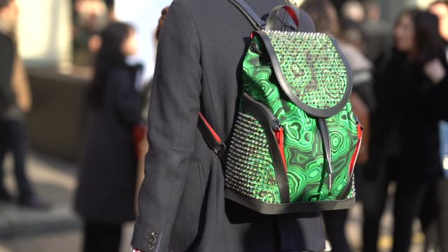 A guest wears a green backpack during Milan Menswear Fashion week Fall/Winter 2018/19 on January 14 2018 in Milan Italy