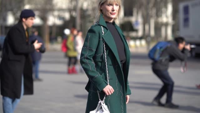 a guest wears a green coat a silver shiny chanel bag silver shoes socks a black dress outside chanel during paris fashion week womenswear fall/winter... - black dress stock videos & royalty-free footage