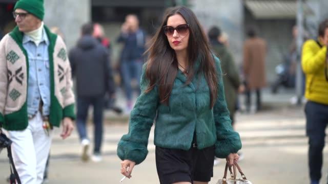 A guest wears a green faux fur coat during Milan Menswear Fashion week Fall/Winter 2018/19 on January 13 2018 in Milan Italy