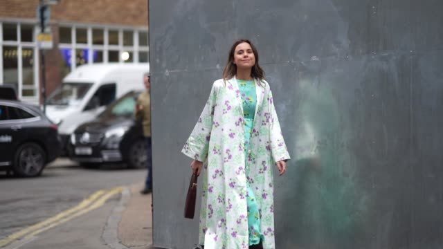 a guest wears a green floral print lustrous silky dress a long vest a brown leather crocodile pattern bag black leather pointy boots during london... - floral pattern stock videos & royalty-free footage