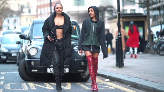 a guest wears a green hoodie red thigh high leather boots a guest wears a black coat black bras black pants during london fashion week men's january... - känga bildbanksvideor och videomaterial från bakom kulisserna