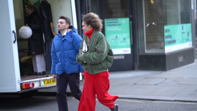 guest wears a green khaki bomber jacket, red pants, during london fashion week men's january 2018 on january 07, 2018 in london, england. - london fashion week点の映像素材/bロール
