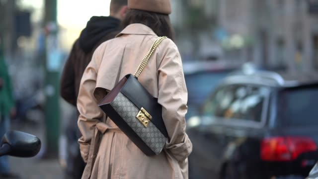 A guest wears a Gucci bag during Milan Menswear Fashion week Fall/Winter 2018/19 on January 13 2018 in Milan Italy
