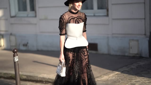 guest wears a hat, a black lace mesh dress with embroidery, a white piece of outfit, outside dior, during paris fashion week - haute couture spring... - mesh textile stock videos & royalty-free footage