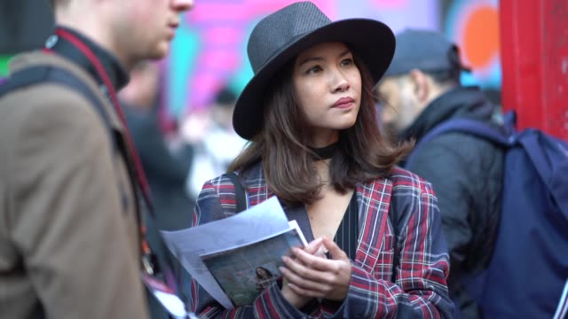 guest wears a hat, a checked blazer jacket, during london fashion week men's january 2018 on january 07, 2018 in london, england. - london fashion week点の映像素材/bロール