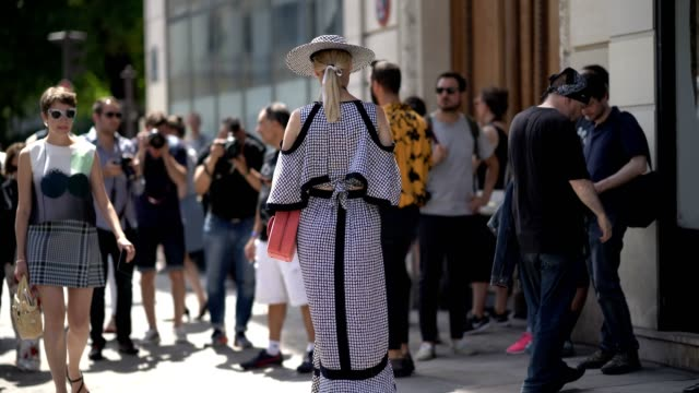 vídeos de stock, filmes e b-roll de a guest wears a hat a checkered outfit outside the jean paul gaultier show during paris fashion week haute couture fall/winter 20172018 on july 05... - hat