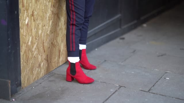 A guest wears a jacket with gingham inner lining a white shirt red shoes during London Fashion Week Men's January 2018 on January 07 2018 in London...
