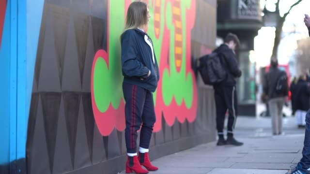 a guest wears a jacket with gingham inner lining a white shirt red shoes during london fashion week men's january 2018 on january 07 2018 in london... - gingham stock videos & royalty-free footage