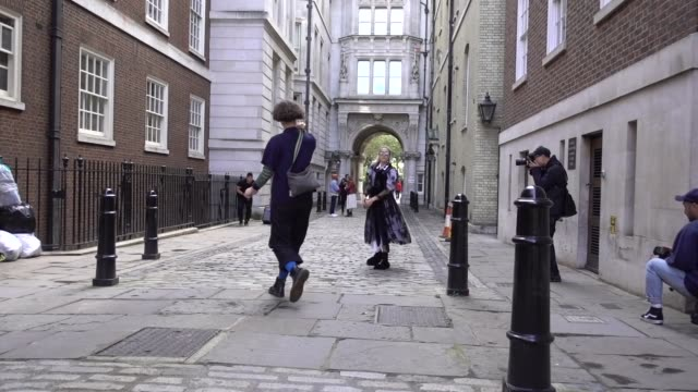 guest wears a lace mesh dress, and a white dress, outside simone rocha, during london fashion week september 2017 on september 16, 2017 in london,... - mesh textile stock videos & royalty-free footage