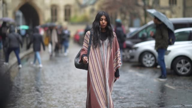 guest wears a long pink striped plaid/poncho, a bag, during london fashion week fall winter 2020 on february 16, 2020 in london, england. - checked pattern stock videos & royalty-free footage
