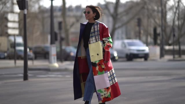 guest wears a multicolor print trench coat, during paris fashion week womenswear fall/winter 2018/2019, on february 28, 2018 in paris, france. - 3日目点の映像素材/bロール