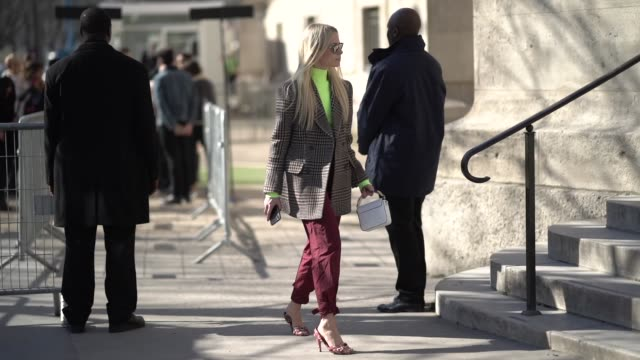a guest wears a neon yellow turtleneck a checked blazer jacket red pants shoes a celine bag outside unravel project during paris fashion week... - turtleneck stock videos & royalty-free footage