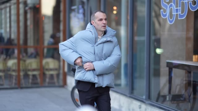 guest wears a pale blue winter puffer jacket, outside viktor & rolf, during paris fashion week - haute couture spring/summer 2020, on january 22,... - paris fashion week - haute couture spring/summer 2020点の映像素材/bロール