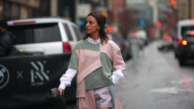 guest wears a patchwork style pullover, a white shirt, a black puff bag, black leather boots, during new york fashion week women's fall-winter 2020,... - patchwork stock videos & royalty-free footage