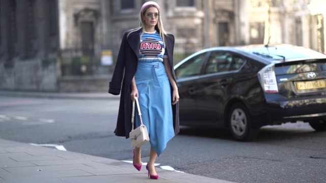 guest wears a pink headband, a miu miu blue t-shirt, a blue skirt, during london fashion week february 2019 on february 15, 2019 in london, england. - hair accessory stock videos & royalty-free footage