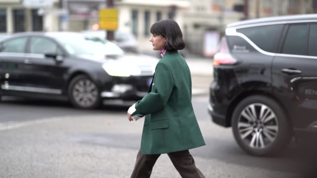 a guest wears a pink prada turtleneck a green jacket brown pants black boots outside nina ricci during paris fashion week womenswear fall/winter... - turtleneck stock videos & royalty-free footage