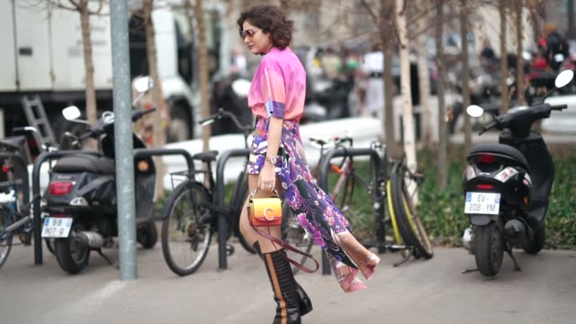 a guest wears a pink tshirt a purple floral print skirt a yellow chloe bag black leather boots outside chloe during paris fashion week womenswear... - pink shirt stock videos and b-roll footage