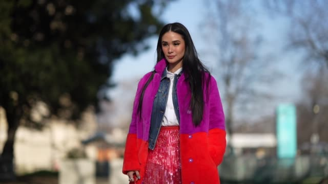 guest wears a purple and red long fluffy winter coat, a blue denim jacket, a white shirt, a red mesh lace skirt, a red mini bag with crocodile... - paris fashion week - haute couture spring/summer 2020点の映像素材/bロール