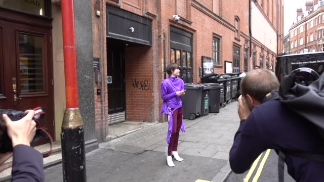 A guest wears a purple outfit outside Fashion East during London Fashion Week September 2017 on September 16 2017 in London England