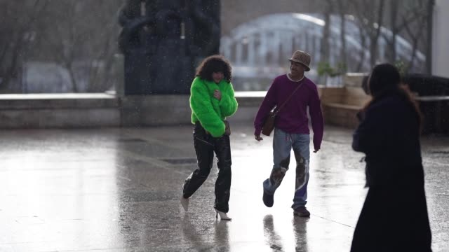 a guest wears a purple pullover and a burberry bob hat a guest wears a green fluffy faux fur jacket outside rick owens during paris fashion week... - guest stock videos & royalty-free footage