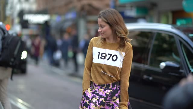 a guest wears a purple skirt a brown pull over 1970 outside house of holland during london fashion week september 2017 on september 16 2017 in london... - anno 1970 video stock e b–roll