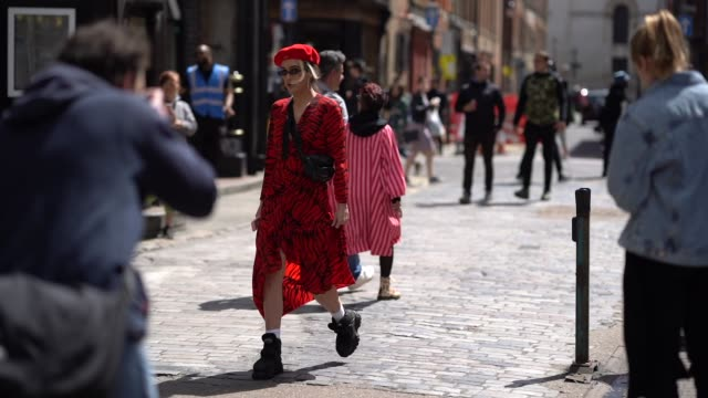 a guest wears a red beret hat a red zebra print dress black boots sunglasses a fanny pack bag during london fashion week men's june 2019 on june 08... - zebra print stock videos & royalty-free footage
