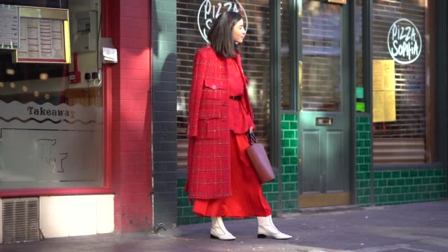a guest wears a red coat a red skirt a red shirt a bag during london fashion week february 2018 on february 17 2018 in london england - london fashion week stock videos and b-roll footage