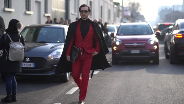 A guest wears a red suit during Milan Menswear Fashion week Fall/Winter 2018/19 on January 14 2018 in Milan Italy