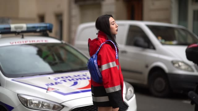 guest wears a red winter coat, black thigh high boots, outside apc, during paris fashion week womenswear fall/winter 2018/2019, on march 5, 2018 in... - thigh human leg stock videos & royalty-free footage