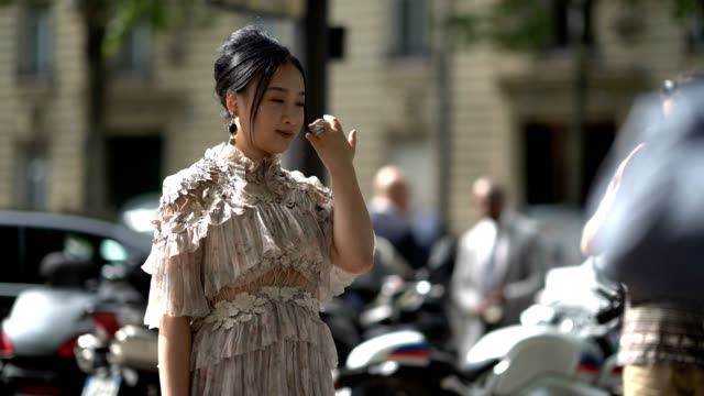 A guest wears a ruffled lace dress and silver heels outside the Zuhair Murad during Paris Fashion Week Haute Couture Fall/Winter 20172018 on July 5...