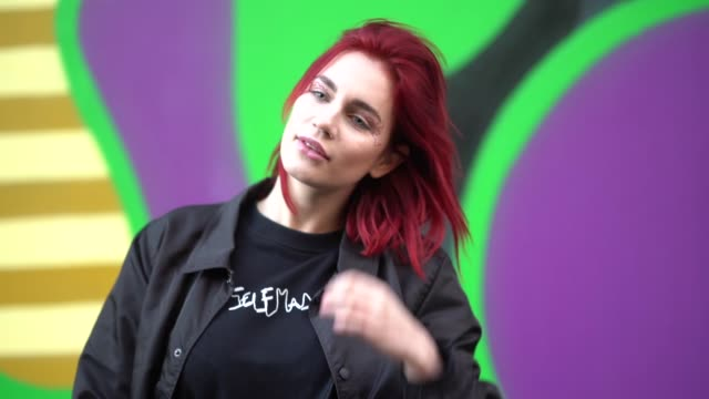 """guest wears a """"selfmade"""" black top, oversize black flare pants, has red hair, during london fashion week men's january 2018 on january 07, 2018 in... - london fashion week点の映像素材/bロール"""