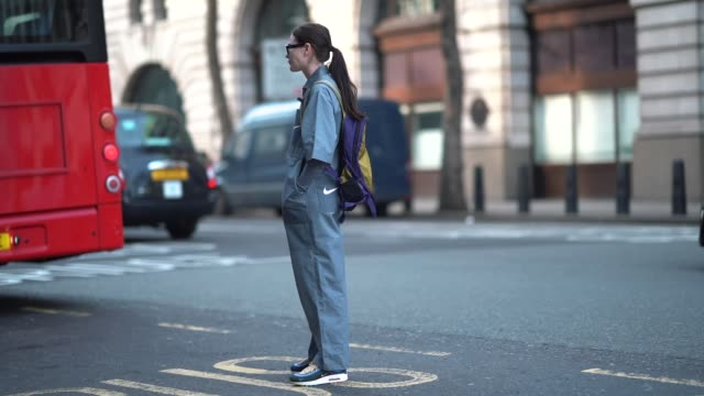 a guest wears a sportswear nike jumpsuit nike sneakers shoes a backpack during london fashion week men's january 2018 at on january 06 2018 in london... - jumpsuit stock videos and b-roll footage