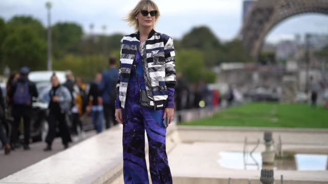 a guest wears a striped jacket a purple outfit outside hermes during paris fashion week womenswear spring/summer 2018 on october 2 2017 in paris... - hermes designer label stock videos and b-roll footage