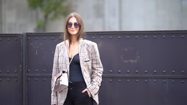 a guest wears a tartan jacket a black top black flare pants outside mugler during paris fashion week womenswear spring/summer 2018 on september 30... - tartan video stock e b–roll