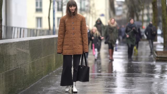 stockvideo's en b-roll-footage met a guest wears a tawny color puffer black crop jeans black and white booties a black bucket bag during paris fashion week womenswear fall/winter... - ski jack