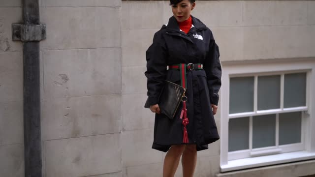 stockvideo's en b-roll-footage met a guest wears a the north face coat a gucci belt a balenciaga clutch and black platform shoes outside simone rocha during london fashion week... - week