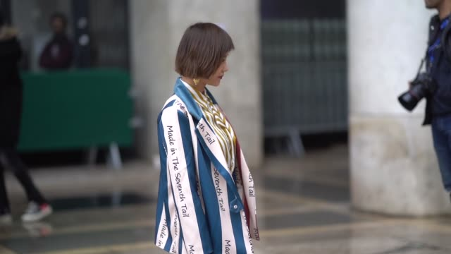 a guest wears a white and yellow striped shirt a multicolor jacket a silver shiny skirt red pvc shoes during paris fashion week womenswear... - pvc stock videos and b-roll footage