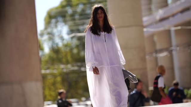 guest wears a white dress, during paris fashion week womenswear spring/summer 2019, on september 26, 2018 in paris, france. - street style stock videos & royalty-free footage