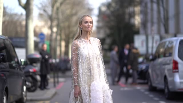 a guest wears a white lace dress outside giambattista valli during paris fashion week womenswear fall/winter 2018/2019 on march 5 2018 in paris france - lace textile stock videos & royalty-free footage