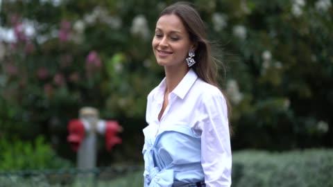 guest wears a white shirt, a blue shirt, blue cropped jeans, outside giambattista valli, during paris fashion week womenswear spring/summer 2018, on... - skjorta bildbanksvideor och videomaterial från bakom kulisserna