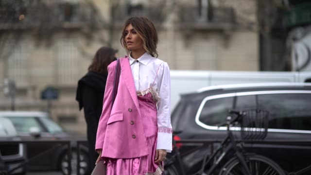 A guest wears a white shirt a pink blazer jacket pink pants outside Miu Miu during Paris Fashion Week Womenswear Fall/Winter 2018/2019 on March 6...