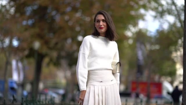 a guest wears a white top a pleated skirt outside chanel during paris fashion week womenswear spring/summer 2018 on october 3 2017 in paris france - skirt stock videos & royalty-free footage