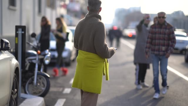 A guest wears a yellow skirt during Milan Menswear Fashion week Fall/Winter 2018/19 on January 14 2018 in Milan Italy