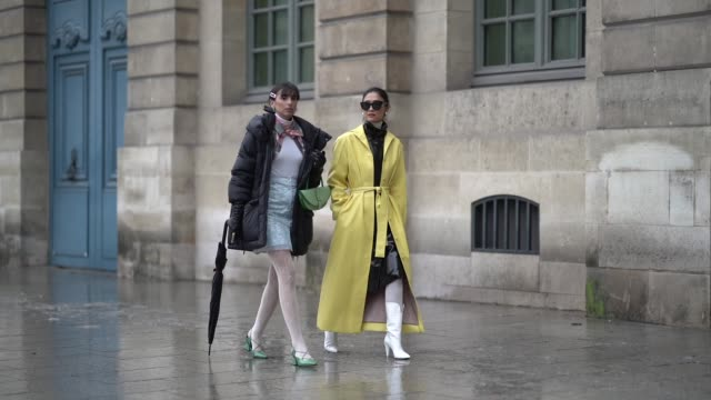 a guest wears a yellow trench coat outside alexis mabille during paris fashion week haute couture spring summer 2020 on january 22 2019 in paris... - spring summer collection stock videos & royalty-free footage