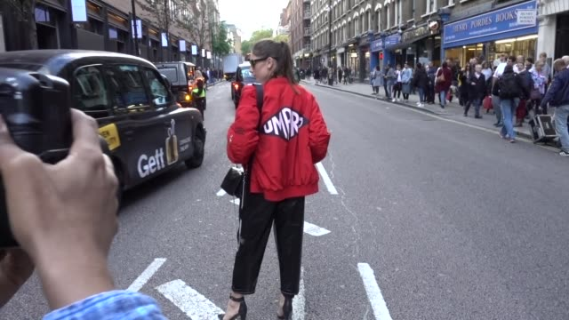 A guest wears an Umbro red bomber jacket outside House of Holland during London Fashion Week September 2017 on September 16 2017 in London England