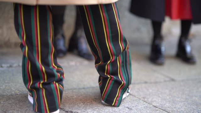 A guest wears colored striped pants during Milan Menswear Fashion week Fall/Winter 2018/19 on January 14 2018 in Milan Italy