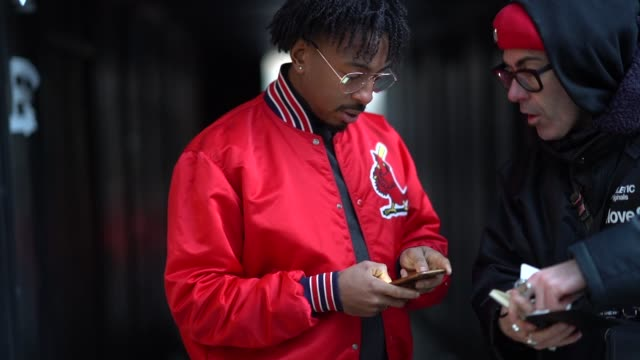 guest wears glasses, a red bomber jacket, during london fashion week men's january 2018 on january 07, 2018 in london, england. - london fashion week点の映像素材/bロール