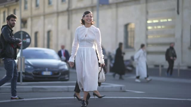 a guest wears hair pins a white dress a prada bag black boots outside prada during milan fashion week fall/winter 20202021 on february 20 2020 in... - boot stock videos & royalty-free footage