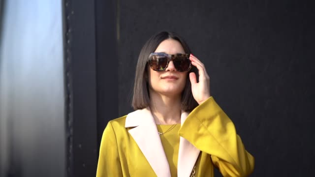 guest wears leo print sunglasses, a yellow outfit, a bimba y lola bag, during london fashion week february 2018 on february 16, 2018 in london,... - fashion week stock videos & royalty-free footage